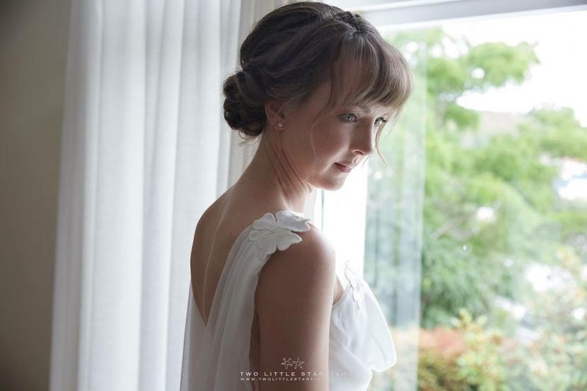 The Bride in her gown before. Getting married. Hair Laurel StratfordHairstyist