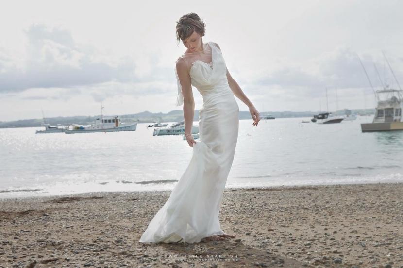 Bride on beach, Russell,NZ. Hair Laurel Stratford Hairstyist.