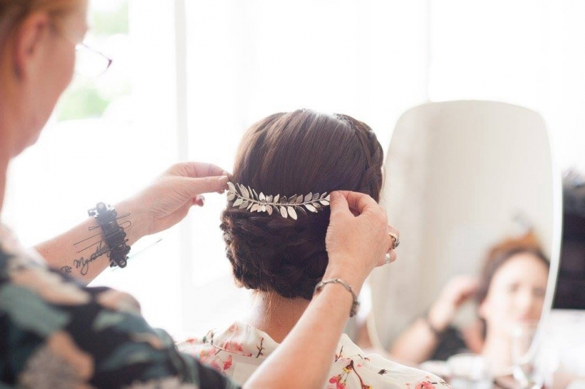 Bridal accessory being added to Bride