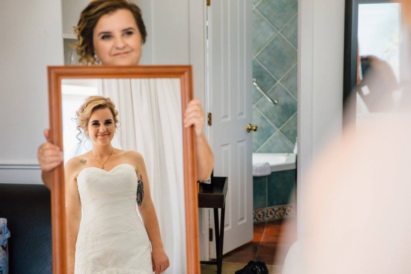 Mother of the Bride holding mirror for the bride. Hair Laurel Stratford wedding hairstylist